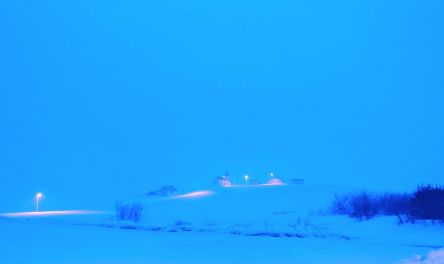 Distant Church Lights In Snow Storm